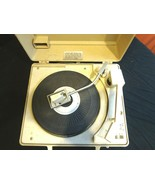 A 1970s GE Solid State Record Player in a portable suitcase-style compact - $19.34