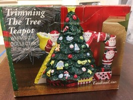 "Ceramic CHRISTMAS TREE SHAPED TEAPOT SANTA HANDLE ELVES TRIMMING TREE 8""... - $15.83"
