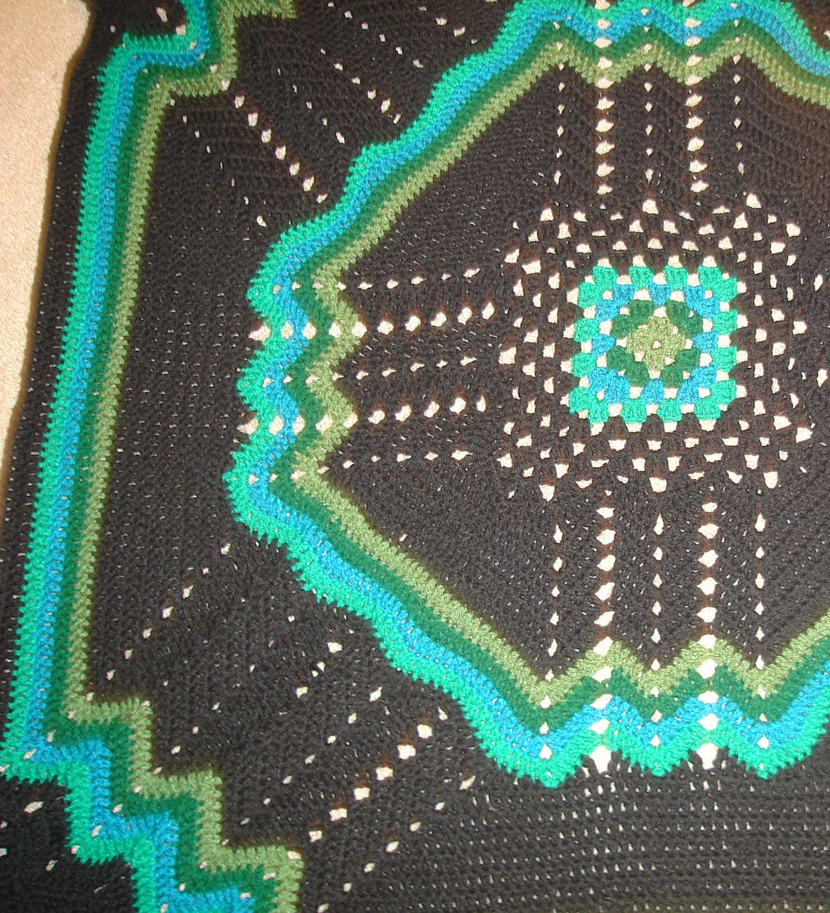 Crocheted afghan/lapghan/coverlet multi greens/black, granny square, ripple