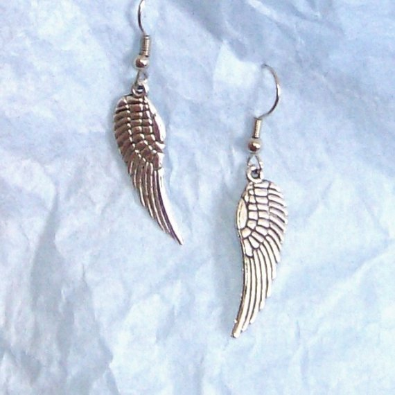 Wing charms perfect for the ear in silver earrings