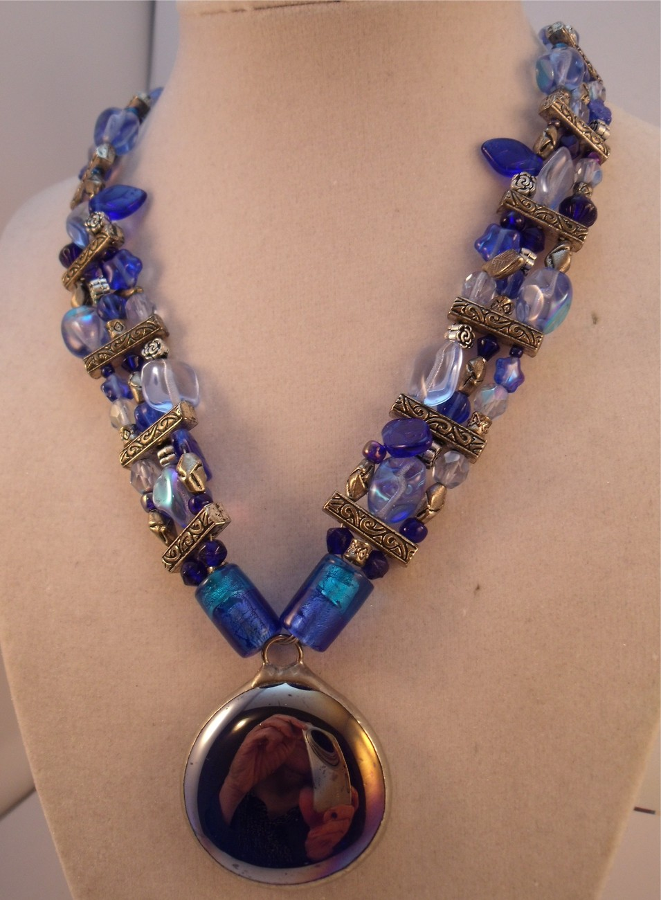 Shades of blue glass bead necklace with cab pendant