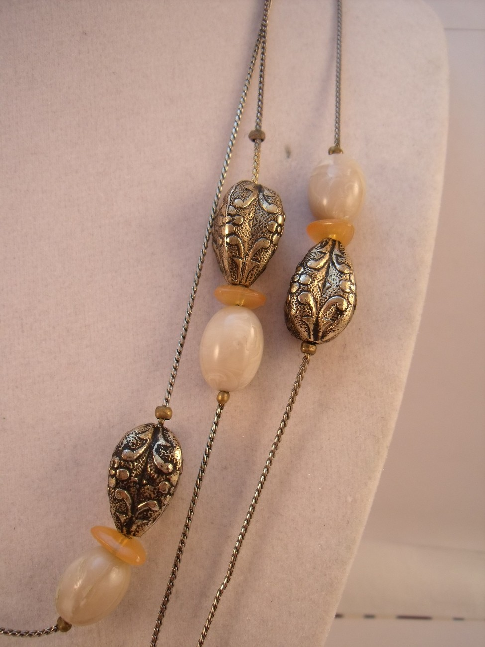 Gold plated chain necklace with beads in shades of gold and cream