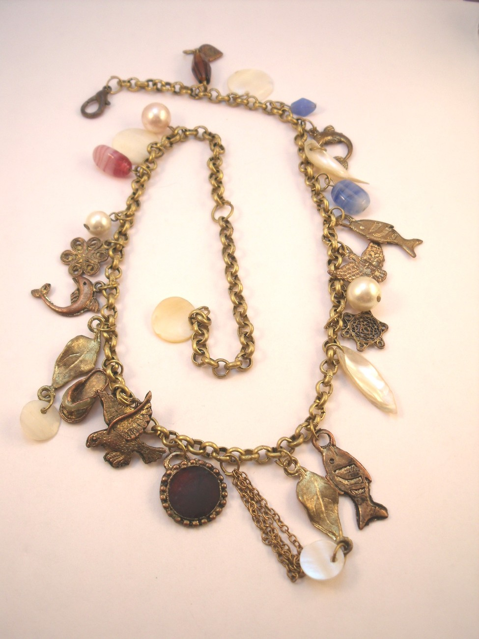 Fun funky charm necklace with lots of birds and fish