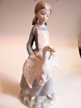 Lladro Nao Figurine Girl with Pigtails holding a Goose with Wings Spread - $56.09
