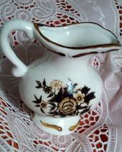 Vintage White Porcelain Small Pitcher Creamer Brown Flower Design - $2.85