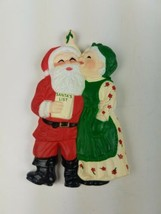 Vintage Hallmark Christmas Magnet Santa & Mrs. Claus kissing under Mistl... - $9.65