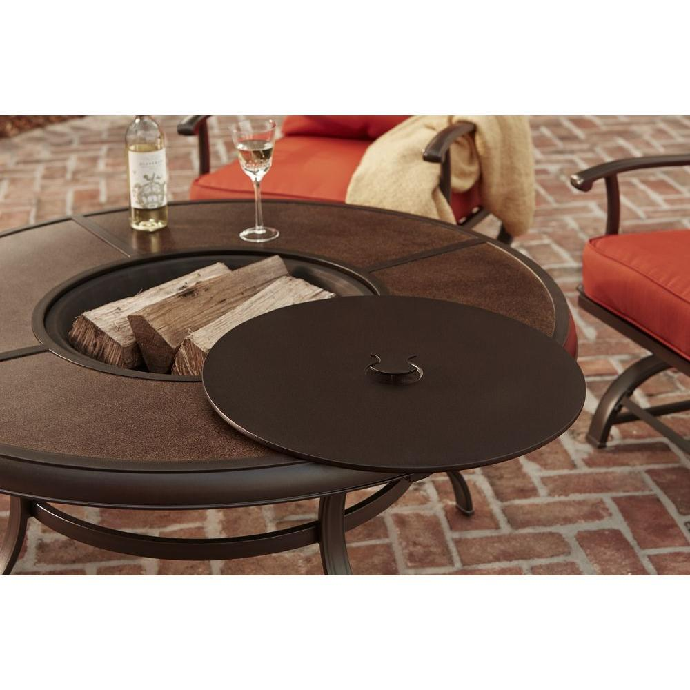 Flaherty 5 Piece steel frame Dining Cushions and Firepit wood centerpiece table