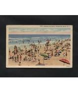 Vintage Linen Postcard Wrightsville Beach NC Sunbathers Ocean Swimmers - $6.99