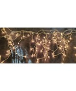 CHRISTMAS HOLIDAY PARTY CLEAR CURTAIN ICICLE LIGHTS - 150 LIGHTS x 2 SETS - $25.00