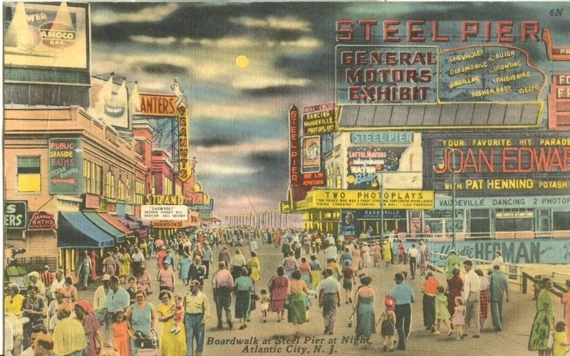 Boardwalk at Steel Pier at Night, Atlantic City, NJ, 1957 used linen Postcard