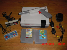 Nintendo NES System MARIO/DUCK HUNT/TRACK MEET, YOSHIS COOKIE - $108.89