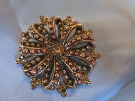 Vintage LIZ CLAIBORNE gold color Pinwheel pin w/rhinestone accents - $15.00