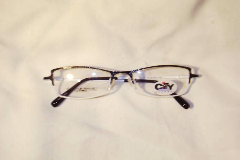 White Designer Eyeglass Frames : Designer eyeglass frame new..Black and White Metal ...