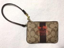 Coach Heritage Brown Sig Signature Stripe Red Print Coated Zip Wristlet - $23.99