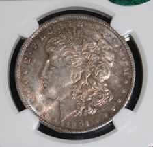 1904 O MS 65 CAC Toned NGC Morgan Silver Dollar - $185.50