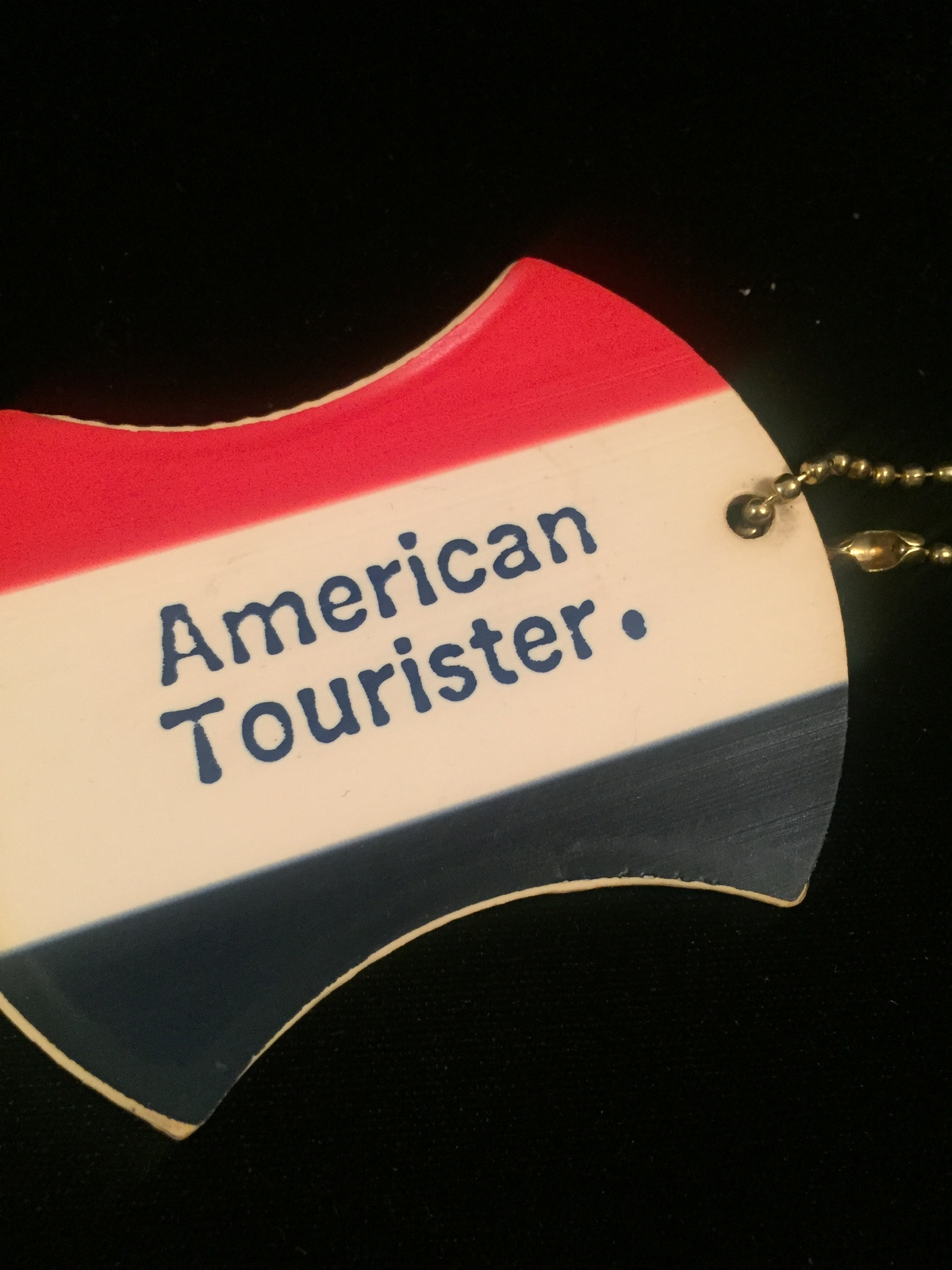 Vintage 70s American Tourister luggage tag (used)