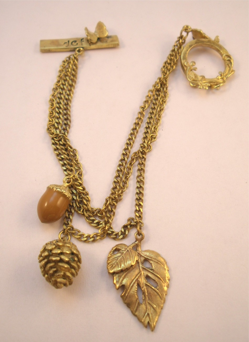Defy toggle bracelet with acorn, pine cone, leaf and butterflies