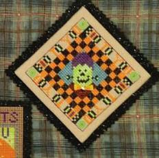 cross stitch spel