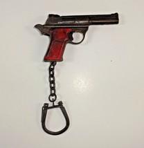 Vtg 1970s era Colt? 1911 Pistol w/ Red Grips Keychain Metal FOB Firearm ... - $17.94
