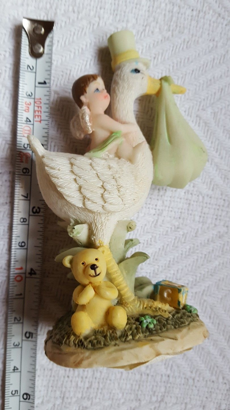 "Primary image for Polystone Baby on Swan, Cake Topper, Baby Shower, Baby Boy with angel wings 5"" H"