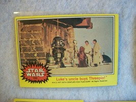 Star Wars Series 3 (Yellow) Topps 1977 Trading Card # 193 Luke's Uncle Buys 3PO - $1.49