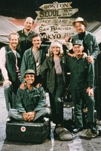 M.A.S.H. Alan Alda Loretta Swit & cast in front of signpost to cities 18x24 Post - $23.99