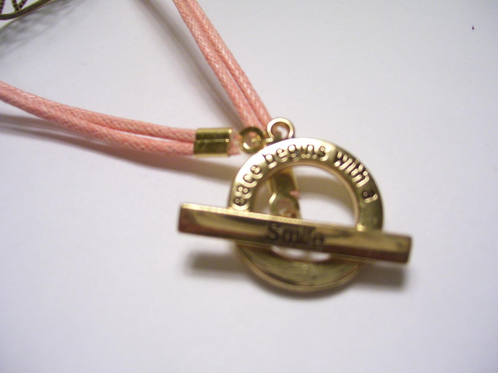 Floral filigree pink Corded Bracelet