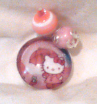 """1"""" Pink Hello Kitty with an umbrella Pendant with glass insert and 2 dan... - $6.00"""