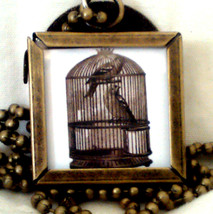Antiqued Bronze 2 sided Locket of vintage bird and bird in a cage with D... - $15.00