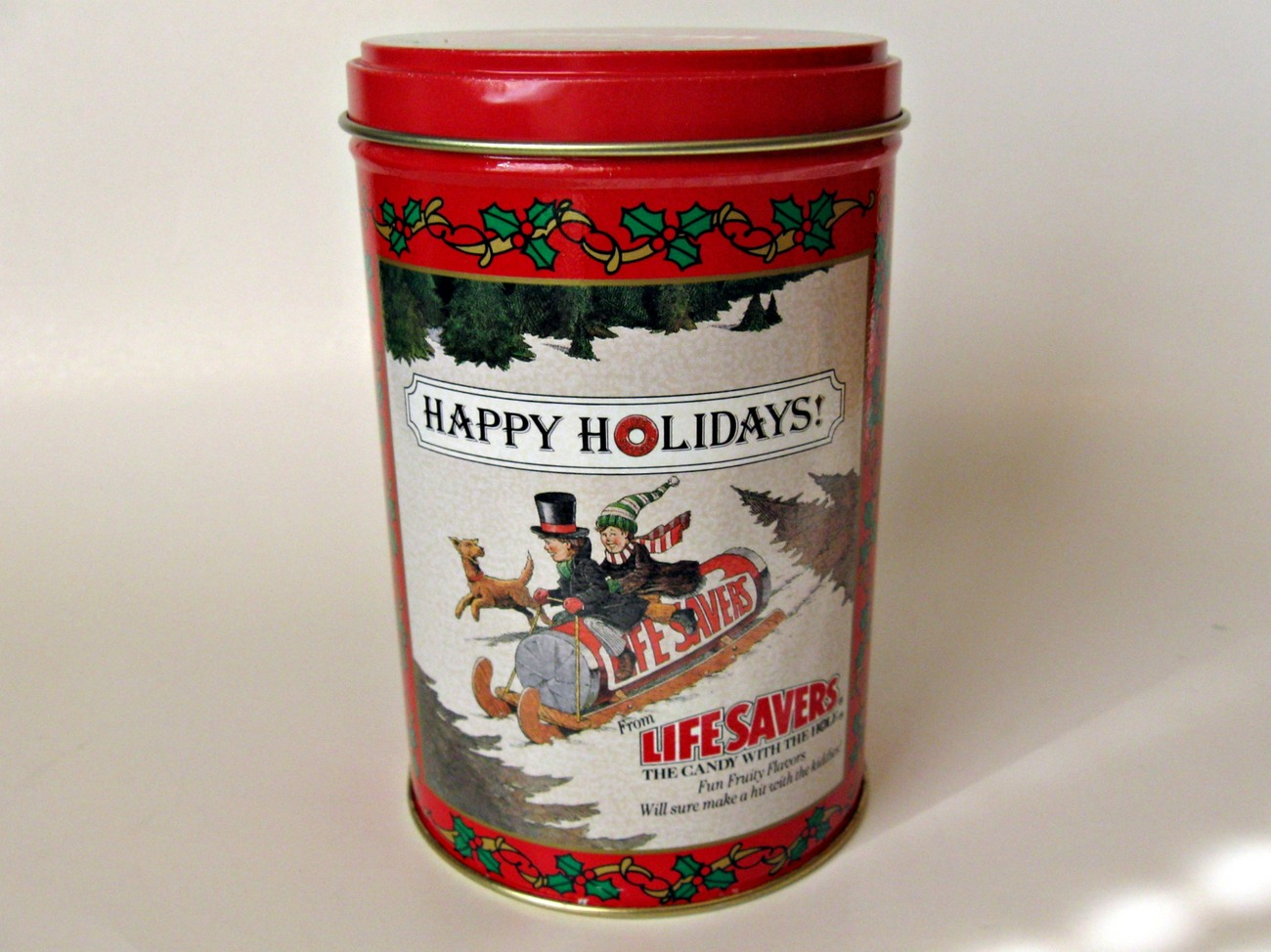 Vintage 1989 collectable Lifesavers tin with winter sledding scene.