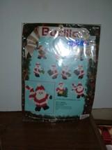 Bucilla  #61136 Jolly Santa  10 Ornaments Plastic Canvas Unopened pkg  1991 - $10.88