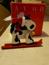 avon holly jolly cow ornament skiing cow - $2.50