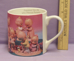 PRECIOUS MOMENTS LRG MUG WITH 14 PICTURES OF PM FIGURES - $10.84