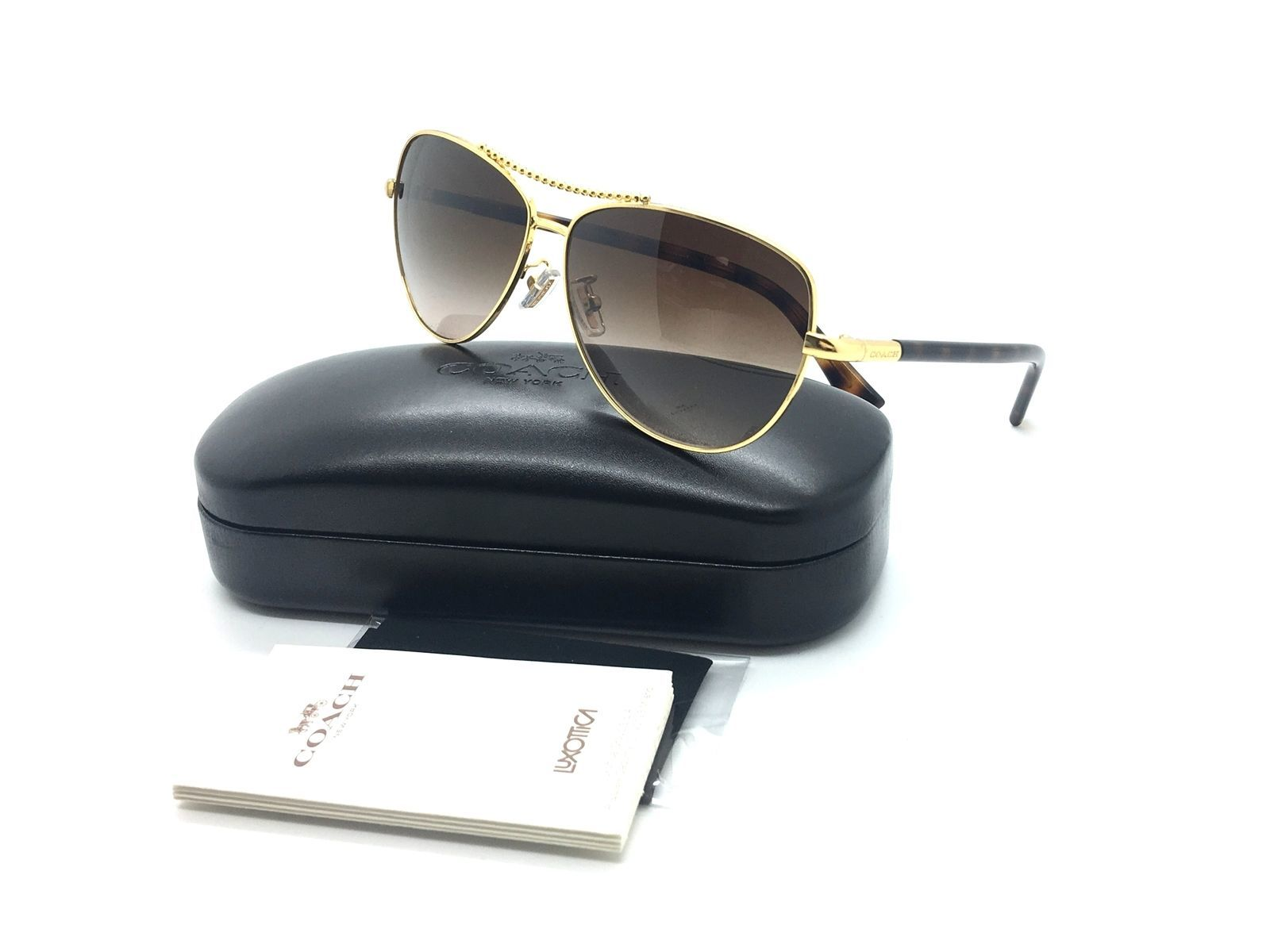 318774fd49e Coach Women Gold Aviator Sunglasses HC 7058 and 50 similar items
