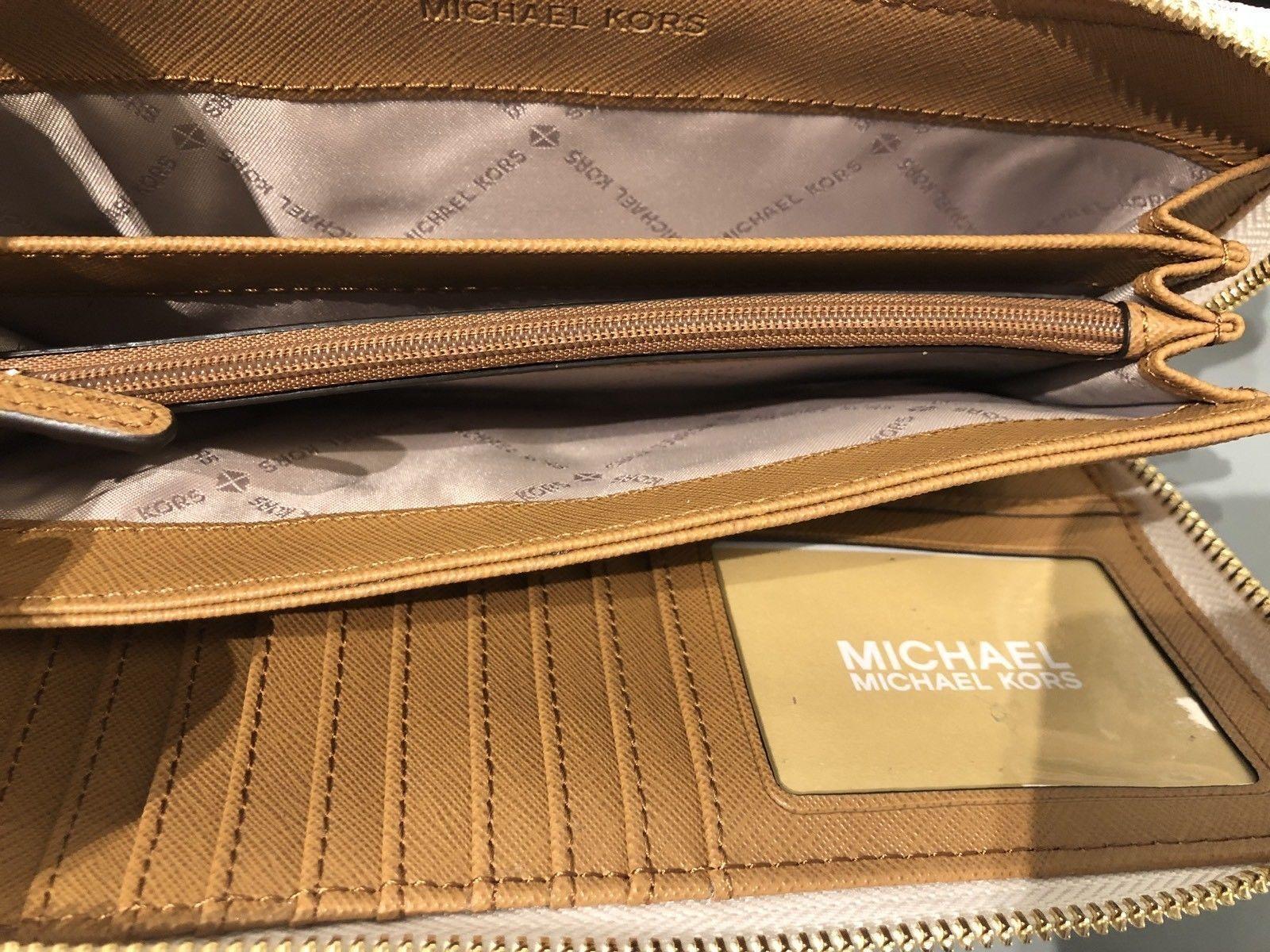 fd542c5098df7 T Michael Kors Mk Logo PVC Jet Set Viaggio Portafoglio Continental In