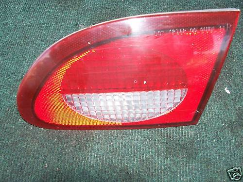 00-02 cavalier taillight right side deck lid mounted