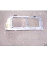 1986 oldsninetyeight right side headlight door w/pklamp - $18.30