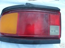 1990 1991 Protege L/S Driver  Tail Light - $13.68