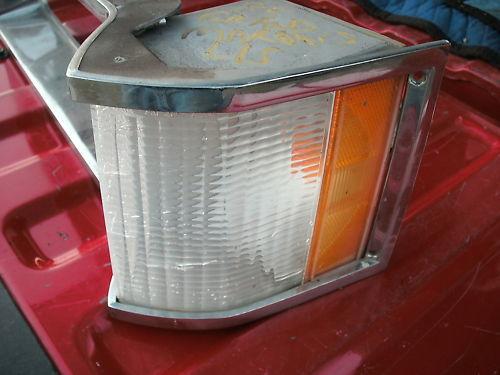79-87 grandmarquis left side headlight door w/ corner