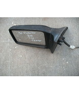 91-96 escort/tracer left  (drivers) side power mirror - $18.30