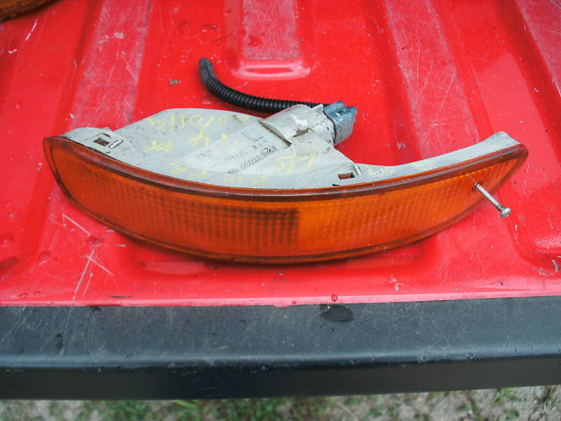 93-97 corolla left front parklamp bumper mounted