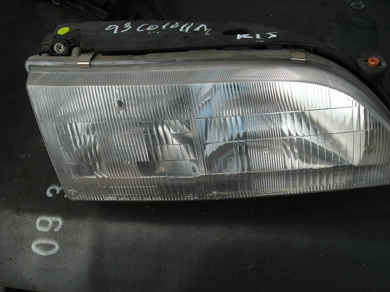 Primary image for 93-97 corolla right or passengerside headlight assembly