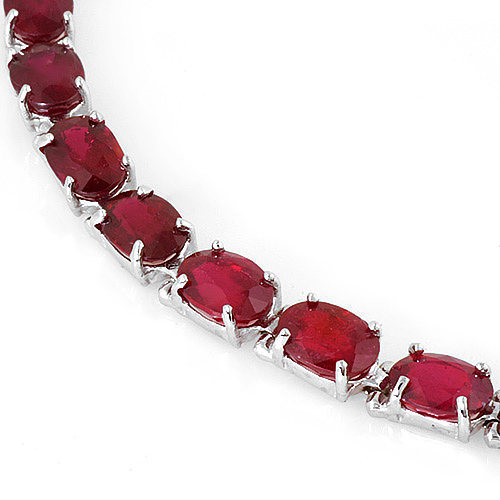 High End 26ctw Ruby tennis bracelet 14k Gold