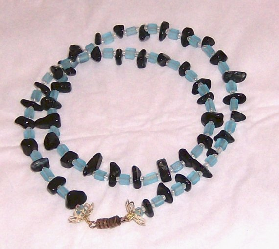 Onyx shards with blue crystal cubes gold bead caps copper tumber clasp necklace
