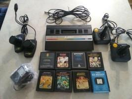 Atari 2600 rainbow  with joysticks, adapter, paddles and 8 games combat etc. - $148.49