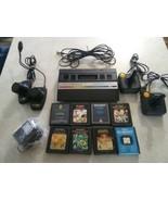 Atari 2600 rainbow  with joysticks, adapter, paddles and 8 games combat ... - $148.49