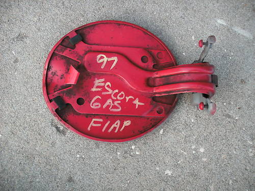 97 escort exterior gas flap round-red in color w/hinge