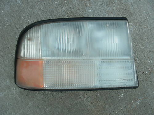 Primary image for 98-04 gmc jimmy right side headlight assembly