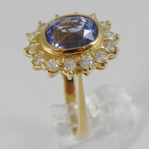 18K YELLOW GOLD BAND FLOWER RING WITH DIAMONDS AND BLUE TOPAZ, MADE IN ITALY image 1