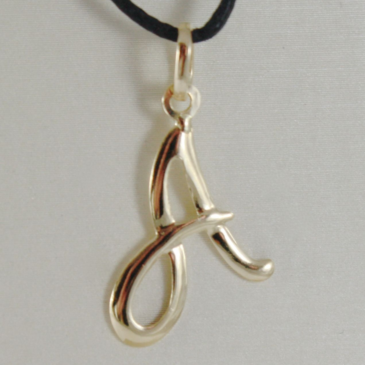 PENDANT SHEET YELLOW GOLD 18K WITH LETTER INITIAL AND CORD BLACK WAXED